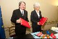 Mr Tsang and Mrs Lagarde exchange documents after signing the agreement for the avoidance of double taxation.