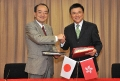 The Secretary for Financial Services and the Treasury, Professor K C Chan (right), signs with the Consul-General of Japan in Hong Kong, Mr Yuji Kumamaru, an agreement for the avoidance of double taxation and the prevention of fiscal evasion with respect to taxes on income today (November 9).