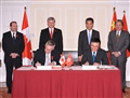 Hong Kong entered into an agreement with Canada today (November 11) for the avoidance of double taxation and the prevention of fiscal evasion with respect to taxes on income. Photo shows the Chief Executive, Mr C Y Leung (back row, second right), and the Prime Minister of Canada, Mr Stephen Harper (back row, second left), witnessing the signing of the agreement by the Secretary for Financial Services and the Treasury, Professor K C Chan (front row, right), and the Canadian Minister of International Trade and Minister for the Asia-Pacific Gateway, Mr Edward Fast (front row, left).